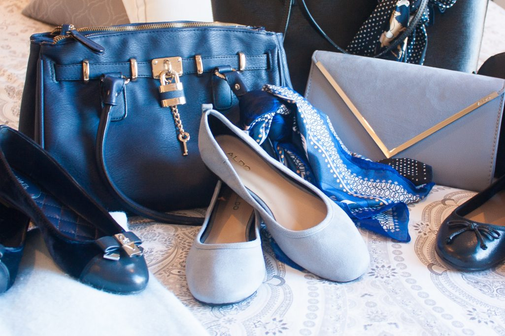 Navy, light blue, and black flats and purses assembly for packing