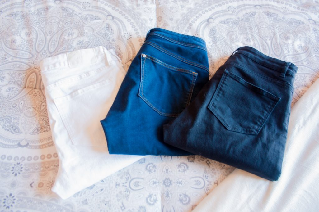 White, navy, and black jeans assembly to be packed