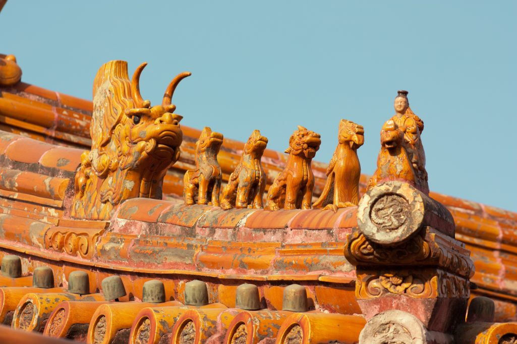 Yellow dragon on the roof of a colourful palace in the forbidden city, Beijing