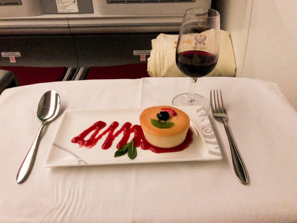 Cheesecake and port wine on Hainan Airlines business class flight