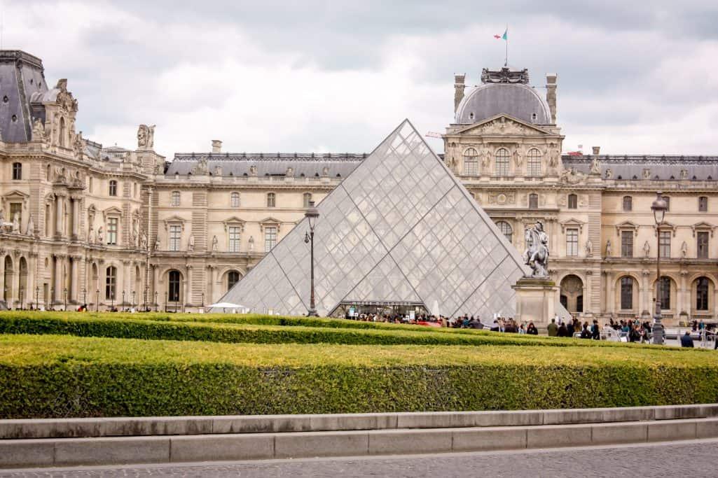 Exploring the Louvre in Paris during our surprise in Paris
