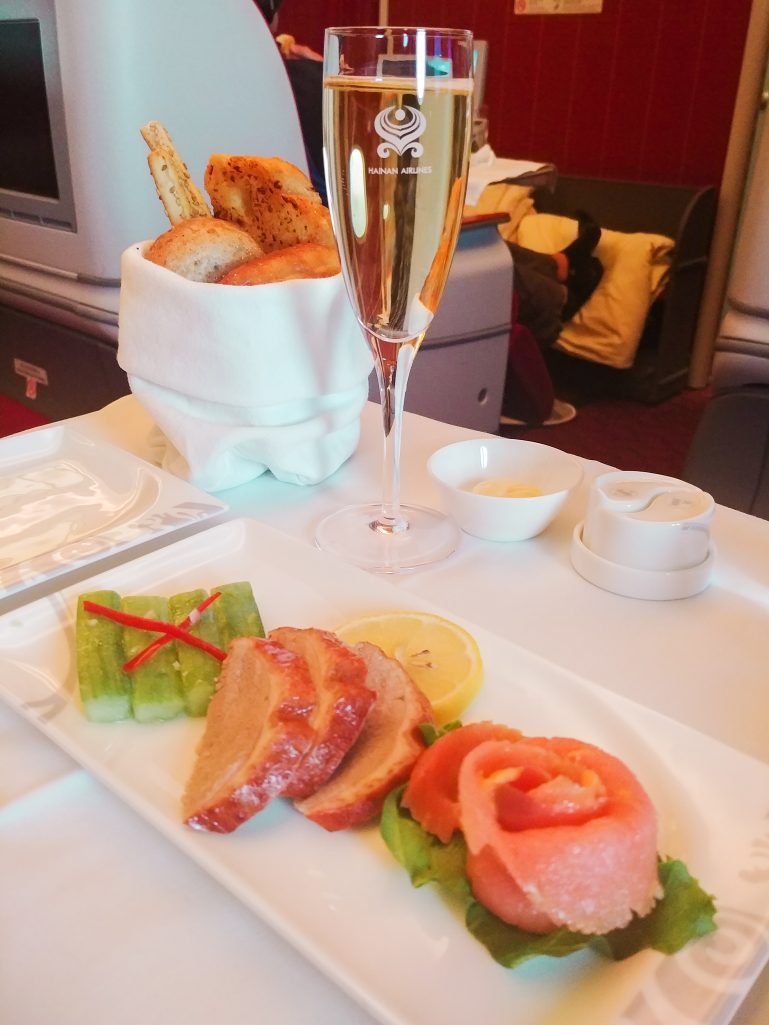 Rose smoked salmon and champagne on Hainan Airlines business class flight
