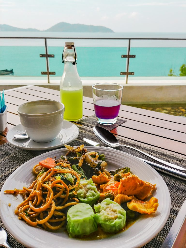 Thai cuisine and different fruit juices at U Zenmaya hotel overlooking the bay