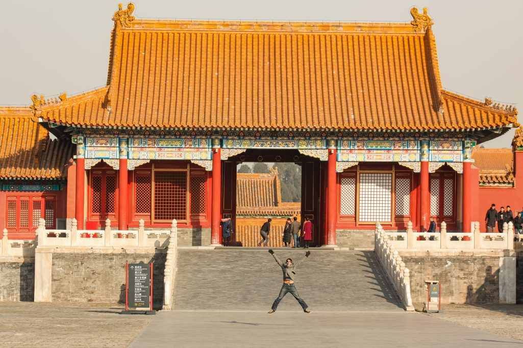 Kyle jumping in front of a palace in the forbidden city, Beijing