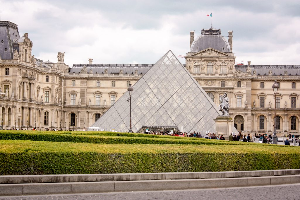 Exploring the Louvre in Paris during our surprise in Paris